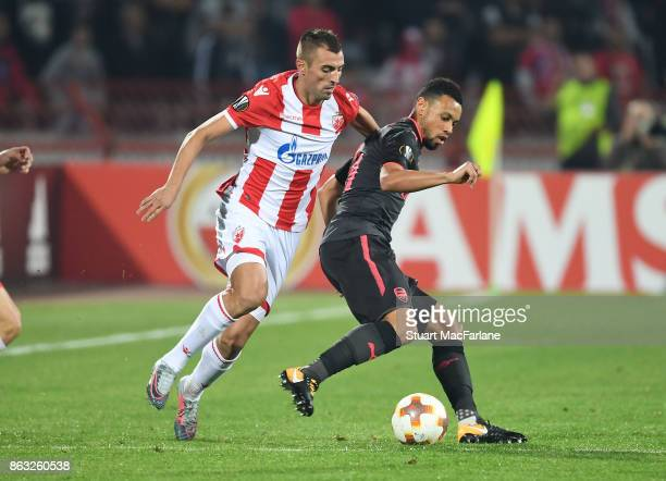 Francis Coquelin of Arsenal takes on Nenad Krsticic of Red Star during the UEFA Europa League group H match between Crvena Zvezda and Arsenal FC at...