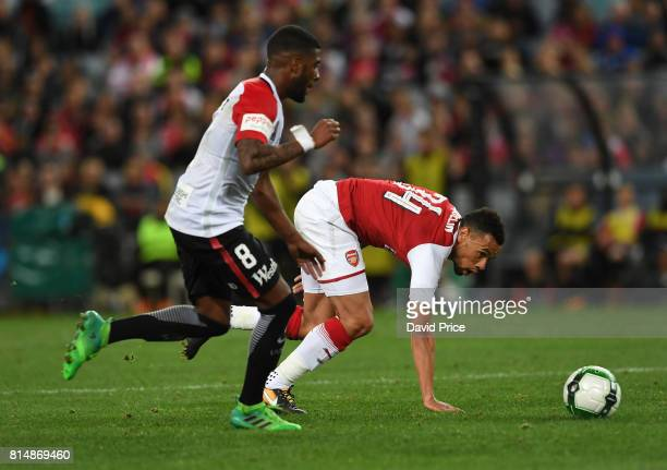 Francis Coquelin of Arsenal takes on Roly Bonevacia of Western Wanderers during the match between the Western Sydney Wanderers and Arsenal FC at ANZ...