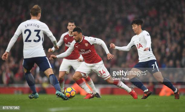 Francis Coquelin of Arsenal takes on Son HeungMin of Tottenham during the Premier League match between Arsenal and Tottenham Hotspur at Emirates...