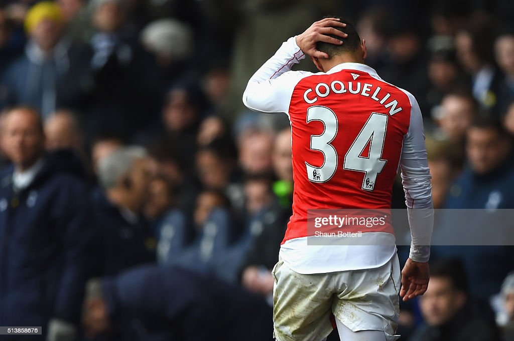 Francis Coquelin of Arsenal walks off the pitch after receiving the red card during the Barclays Premier League match between Tottenham Hotspur and...