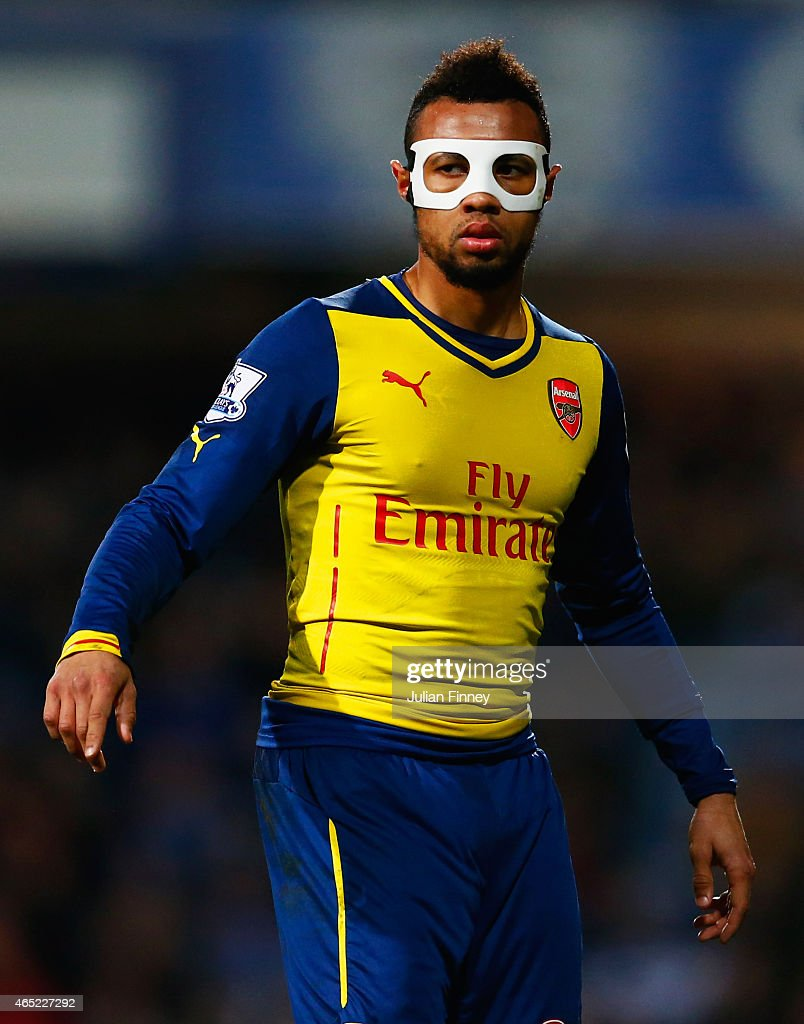 Francis Coquelin of Arsenal wears a protective face mask during the Barclays Premier League match between Queens Park Rangers and Arsenal at Loftus...