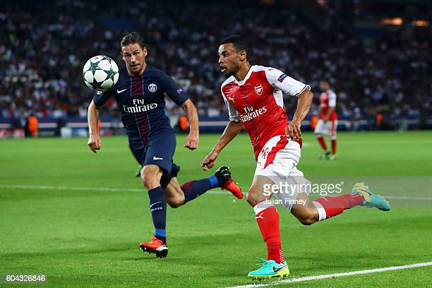 Francis Coquelin of Arsneal and Maxwell of PSG in action during the UEFA Champions League Group A match between Paris SaintGermain and Arsenal FC at...