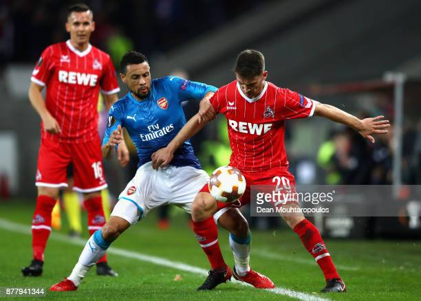 Francis Coquelin of Arsneal and Salih Oezcan of FC Koeln battle for possession during the UEFA Europa League group H match between 1 FC Koeln and...
