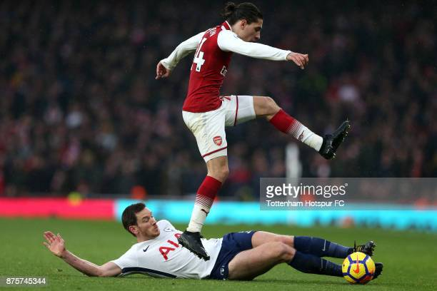 Francis Coquelin of Arsneal is tackled by Jan Vertonghen of Tottenham Hotspur during the Premier League match between Arsenal and Tottenham Hotspur...