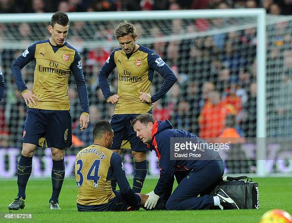 Francis Coquelin recieves treatment from Physio Colin Lewin during the Barclays Premier League match between West Bromwich Albion and Arsenal at The...