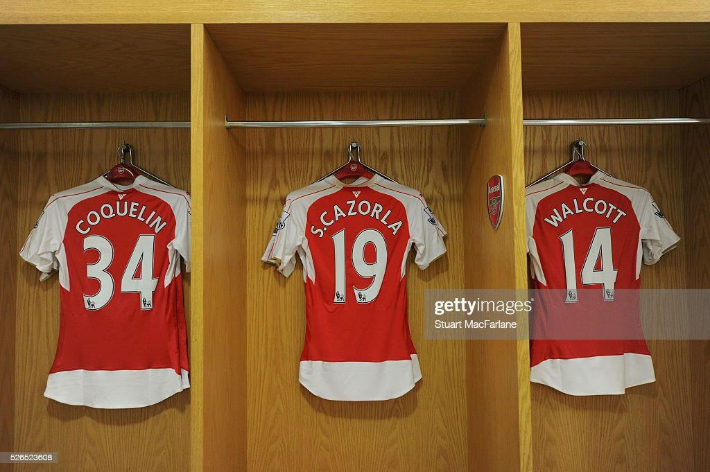 Francis Coquelin, Santi Cazorla and Theo Walcott shirt's in the Arsenal changing room changing room before the Barclays Premier League match between Arsenal and Norwich City at Emirates Stadium on April 30, 2016 in London, England.