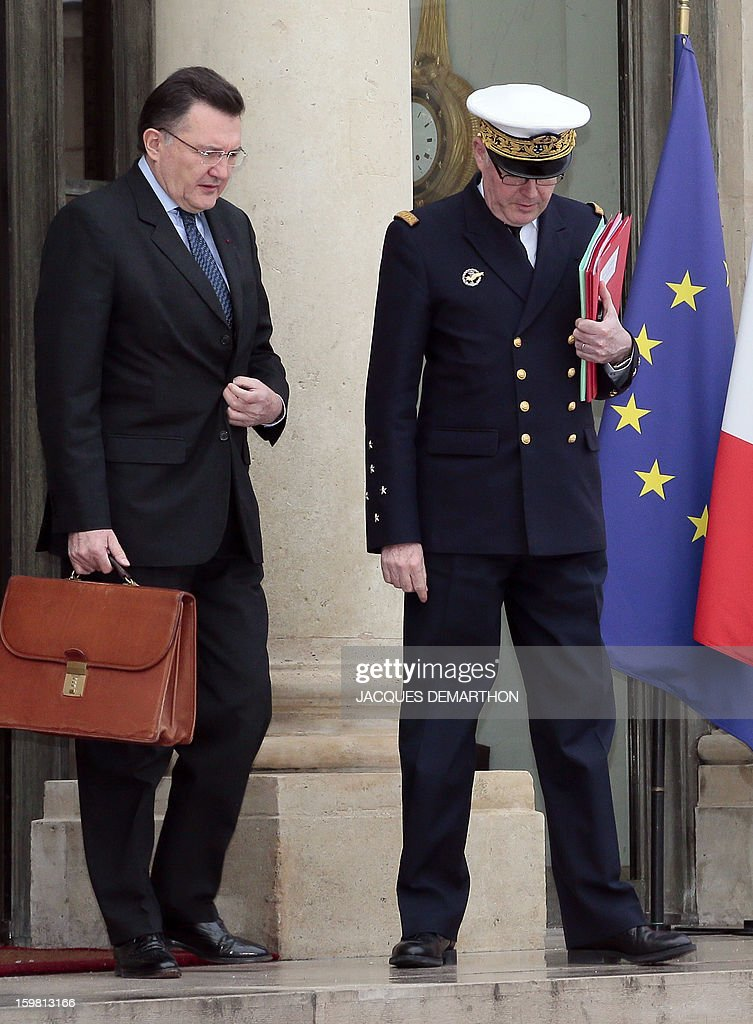 Francis Delon, general secretary of French Defence and National Security (L) and Admiral Edouard Guillaud (R), France's armies chief of staff, leave the presidential Elysee palace on January 21, 2013 in Paris, after a meeting with France's President on the situations in Mali and Algeria. French troops on Sunday consolidated gains in Mali's Islamist-held north as Paris said the aim was its 'total reconquest' and Canada, Germany and Russia offered vital aid for the offensive. The Al-Qaeda-linked group that shocked the world with its audacious hostage attack in neighbouring Algeria threatened meanwhile to stage further reprisal strikes on nations involved in chasing out Islamists from Mali.