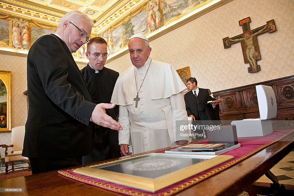 Francis (R) exchanges gifts with Croatia's President <a gi-track='captionPersonalityLinkClicked' href=/galleries/search?phrase=Ivo+Josipovic&family=editorial&specificpeople=6599425 ng-click='$event.stopPropagation()'>Ivo Josipovic</a> (L) during an audience at his studio on October 10, 2013 in Vatican City, Vatican. During discussions the pontif made a reference to Croatia's long Catholic tradition and the good bilateral relations.