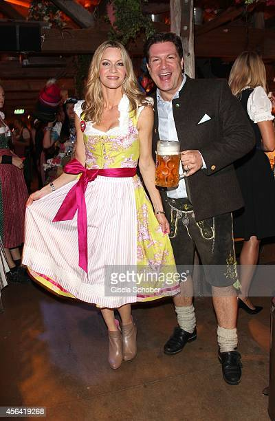 Francis Fulton Smith and his wife Verena Klein during Oktoberfest at Kaeferzelt/Theresienwiese on September 30 2014 in Munich Germany