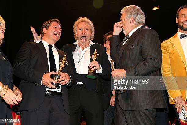 Francis FultonSmith Thomas Gottschalk sings Placido Domingo with award during the 'Die Goldene Deutschland' Gala on July 26 2015 at Cuvillies Theater...