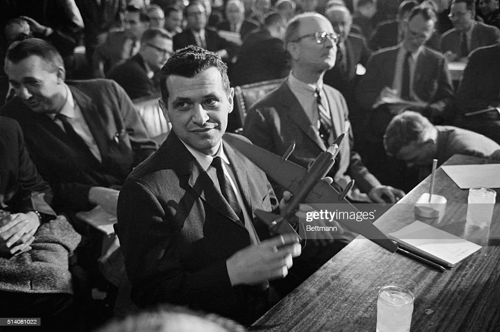 Francis Gary Powers holds a model of a U2 spy plane as he testifies before the Senate Armed Services Committee Powers' plane was shot down by the...