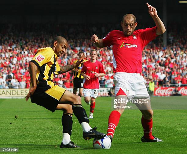 Francis Green of Boston United is put under pressure by Steve Evans of Wrexham during CocaCola Football League Two game between Wrexham and Boston...