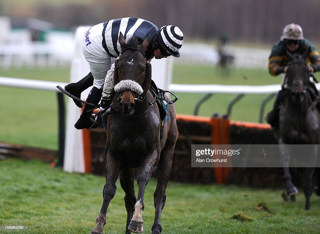 Francis Hayes riding Dan Breen manages to stay on his mount after stumbling at the last in The CF Roberts Electrical + Mechanical Services Handicap Hurdle Race at Cheltenham racecourse on December 14, 2012 in Cheltenham, England.