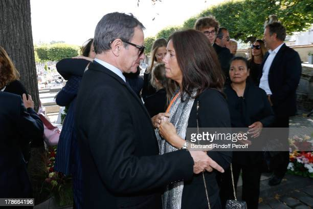 Francis Huster and Cristiana Reali attend President of FIFA protocol Doctor Pierre Huth's Funeral in Nogent Sur Marne cemetery on August 30 2013 in...