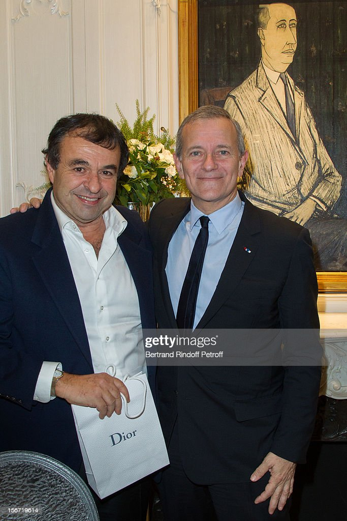 Francis Huster (R) and Cyril Mansour attend the signing of Huster's book 'And Dior Created Woman' at Dior Boutique on November 19, 2012 in Paris, France.