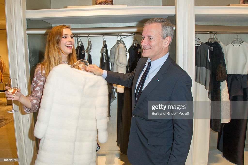 Francis Huster (R) and Gaia Weiss attend the signing of Huster's book 'And Dior Created Woman' at Dior Boutique on November 19, 2012 in Paris, France.