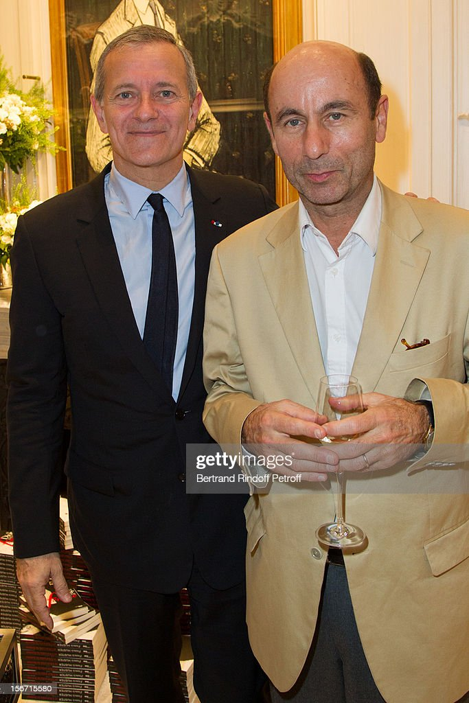 Francis Huster (L) and Philippe Heracles, CEO of Le Cherche Midi publishing house, attend the signing of Huster's book 'And Dior Created Woman' at Dior Boutique on November 19, 2012 in Paris, France.
