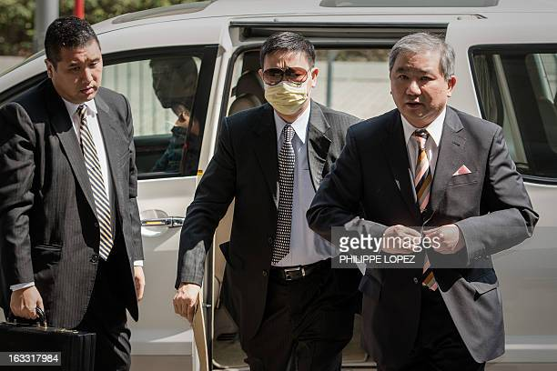 Francis Kwan former nonexecutive director of New Environmental Energy Holdings Ltd arrives at the court for a hearing on a corruption case in Hong...