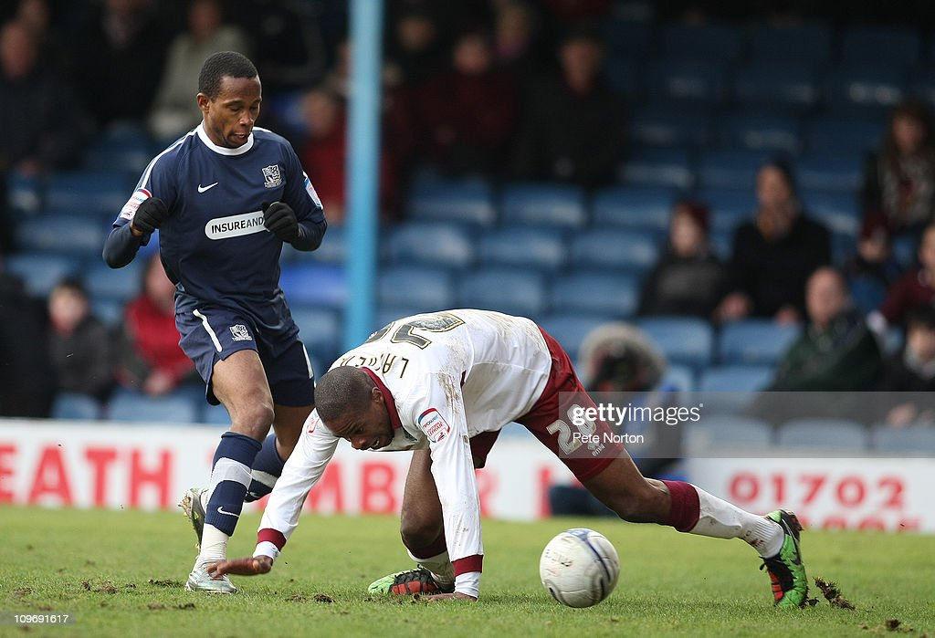 Francis Laurent of Northampton Town attempts to control the ball watched by Miguel Comminges of Southend United during the npower League Two match between Southend United and Northampton Town at Roots Hall on February 26, 2011 in Southend, England.