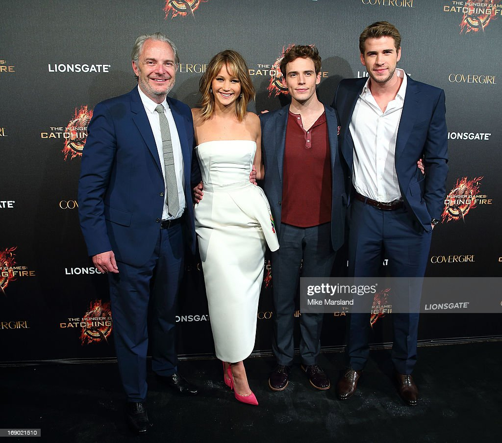 <a gi-track='captionPersonalityLinkClicked' href=/galleries/search?phrase=Francis+Lawrence&family=editorial&specificpeople=224820 ng-click='$event.stopPropagation()'>Francis Lawrence</a>, <a gi-track='captionPersonalityLinkClicked' href=/galleries/search?phrase=Jennifer+Lawrence&family=editorial&specificpeople=1596040 ng-click='$event.stopPropagation()'>Jennifer Lawrence</a>, <a gi-track='captionPersonalityLinkClicked' href=/galleries/search?phrase=Sam+Claflin&family=editorial&specificpeople=7238693 ng-click='$event.stopPropagation()'>Sam Claflin</a> and <a gi-track='captionPersonalityLinkClicked' href=/galleries/search?phrase=Liam+Hemsworth&family=editorial&specificpeople=6338547 ng-click='$event.stopPropagation()'>Liam Hemsworth</a> attend a party for 'The Hunger Games: Catching Fire' at The 66th Annual Cannes Film Festival at Baoli Beach on May 18, 2013 in Cannes, France.