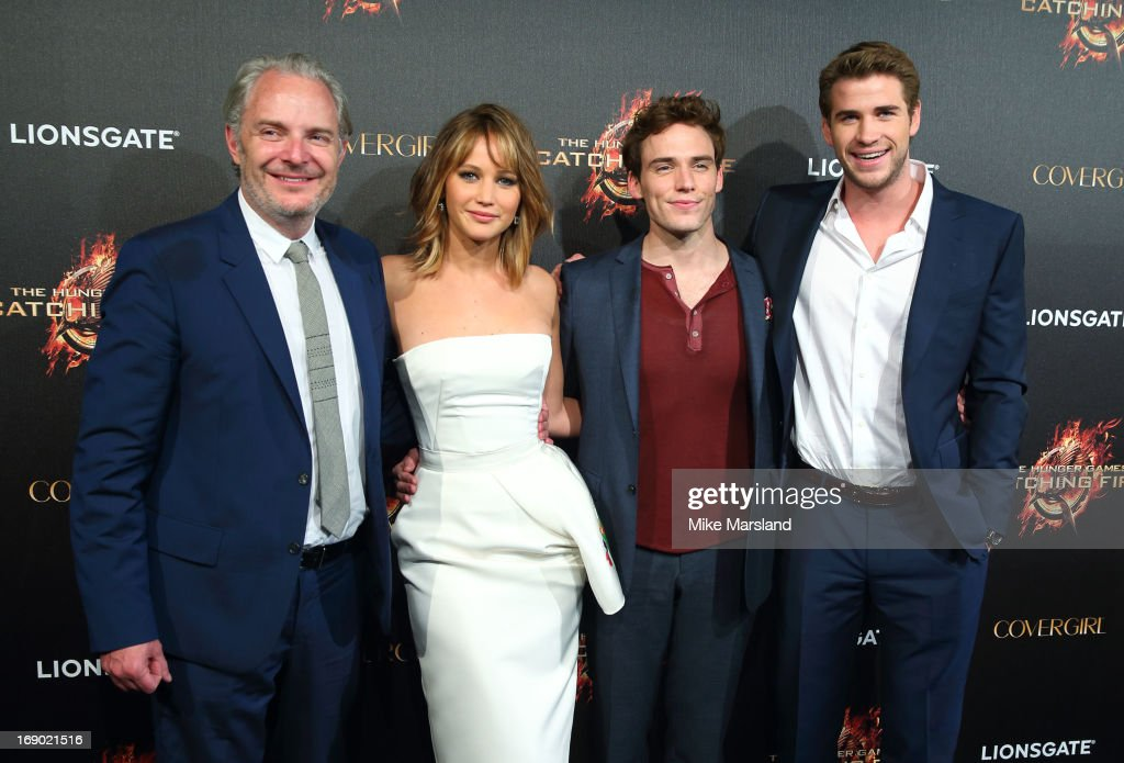 Francis Lawrence, Jennifer Lawrence, Sam Claflin and Liam Hemsworth attend a party for 'The Hunger Games: Catching Fire' at The 66th Annual Cannes Film Festival at Baoli Beach on May 18, 2013 in Cannes, France.