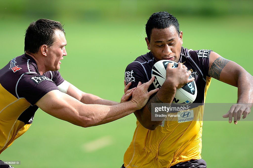 Francis Molo attempts to break away from the defence during a Brisbane Broncos NRL training session on February 28, 2013 in Brisbane, Australia.