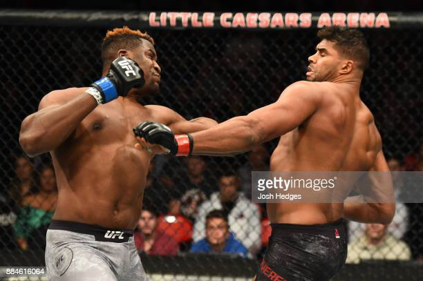 Francis Ngannou of Cameroon punches Alistair Overeem of The Netherlands in their heavyweight bout during the UFC 218 event inside Little Caesars...