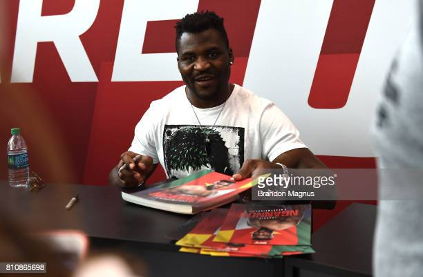 Francis Ngannou of France meets with fans during an autograph session at TMobile Arena on July 8 2017 in Las Vegas Nevada