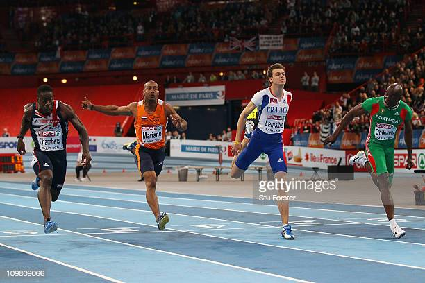 Francis Obikwelu of Portugal wins the gold medal from Dwain Chambers of Great Britain and Northern Ireland and Christophe Lemaitre of France in the...