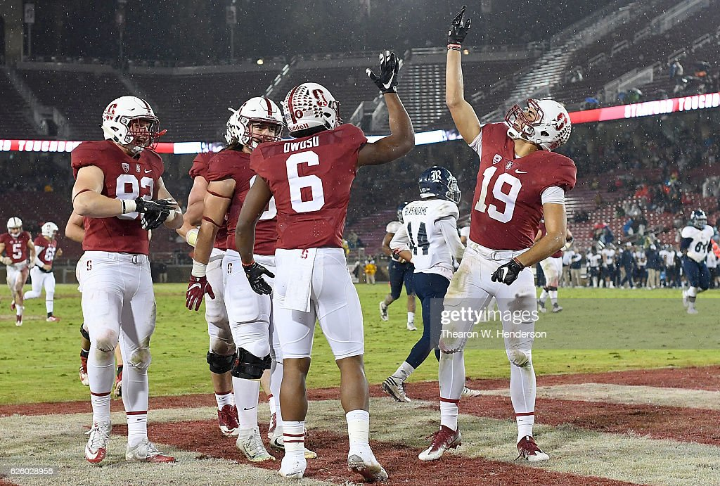 Francis Owusu #6 and JJ Arcega-Whiteside #19 of the Stanford Cardinal celebrates after Owusu catches a fourty six yard touchdown pass against the Rice Owls in the third quarter of their NCAA football game at Stanford Stadium on November 26, 2016 in Palo Alto, California.