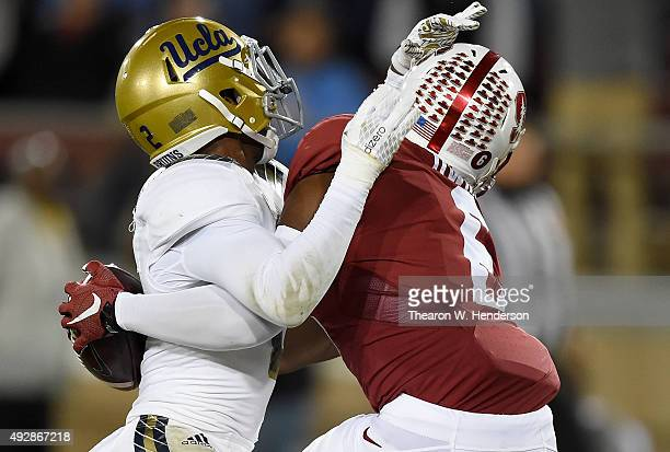 Francis Owusu of the Stanford Cardinal's catches a touchdown pass up against the back of Jaleel Wadood of the UCLA Bruins in the third quarter of an...