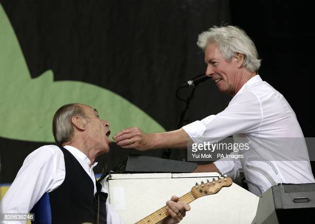 Francis Rossi and Andy Bown of Status Quo performing during the 2009 Glastonbury Festival at Worthy Farm in Pilton Somerset