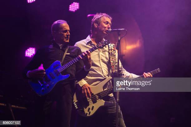 Francis Rossi and John 'Rhino' Edwards of Status Quo perform at Rewind Festival on August 20 2017 in HenleyonThames England