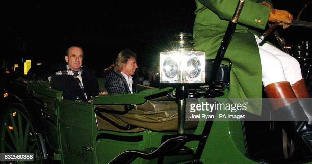 Francis Rossi and Rick Parfitt of Status Quo arrive by horse drawn carriage to Harrods in Knightsbridge central London to sign copies of their new...