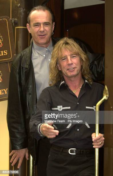 Francis Rossi and Rick Parfitt of Status Quo board the Orient Express at Victoria Station in London The band are travelling to Portsmouth where they...