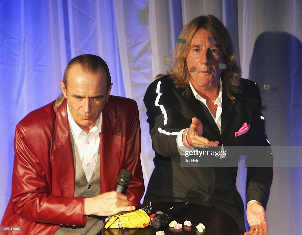 Francis Rossi and Rick Parfitt of Status Quo sign a guitar at the DVD Launch party for poprock veterans Status Quo celebrating the November 7 release...