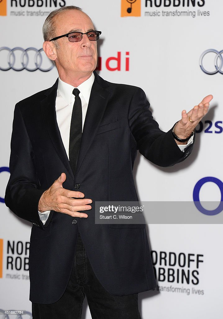 <a gi-track='captionPersonalityLinkClicked' href=/galleries/search?phrase=Francis+Rossi&family=editorial&specificpeople=243185 ng-click='$event.stopPropagation()'>Francis Rossi</a> attends the Nordoff Robbins 02 Silver Clef awards at London Hilton on July 4, 2014 in London, England.