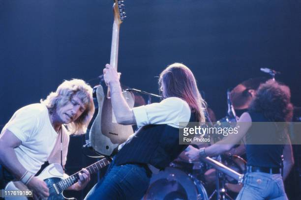 Francis Rossi guitarist and singer and guitarist Rick Parfitt of British rock band Status Quo on stage playing their guitars during a live concert...