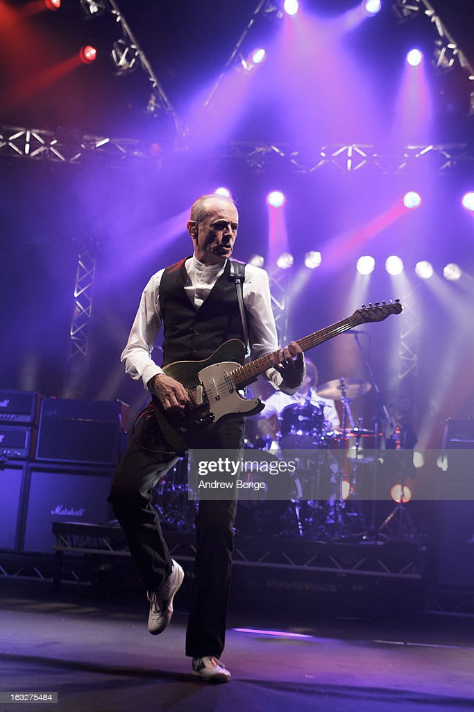<a gi-track='captionPersonalityLinkClicked' href=/galleries/search?phrase=Francis+Rossi&family=editorial&specificpeople=243185 ng-click='$event.stopPropagation()'>Francis Rossi</a> of Status Quo performs on stage in concert at Manchester Apollo on March 6, 2013 in Manchester, England.