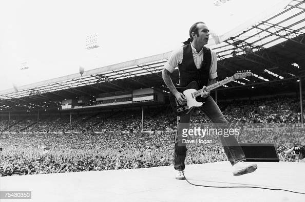Francis Rossi singer and guitarist with British rock group Status Quo in the opening performance at the Live Aid charity concert Wembley London 13th...