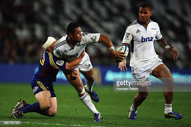 Francis Saili of the Blues offloads the ball during the round 16 Super Rugby match between the Highlanders and the Blues at Forsyth Barr Stadium on...