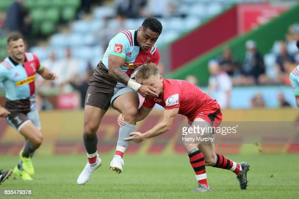 Francis Sali of Harlequins and Joel Dudley of Jersey Reds battle for possession during the pre season match between Harlequins and Jersey Red at the...