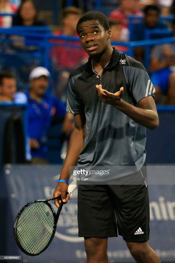 <a gi-track='captionPersonalityLinkClicked' href=/galleries/search?phrase=Francis+Tiafoe&family=editorial&specificpeople=10095812 ng-click='$event.stopPropagation()'>Francis Tiafoe</a> of the United States reacts to a shot while playing <a gi-track='captionPersonalityLinkClicked' href=/galleries/search?phrase=Evgeny+Donskoy&family=editorial&specificpeople=5368047 ng-click='$event.stopPropagation()'>Evgeny Donskoy</a> of Russia during the Citi Open at the William H.G. FitzGerald Tennis Center on July 28, 2014 in Washington, DC.