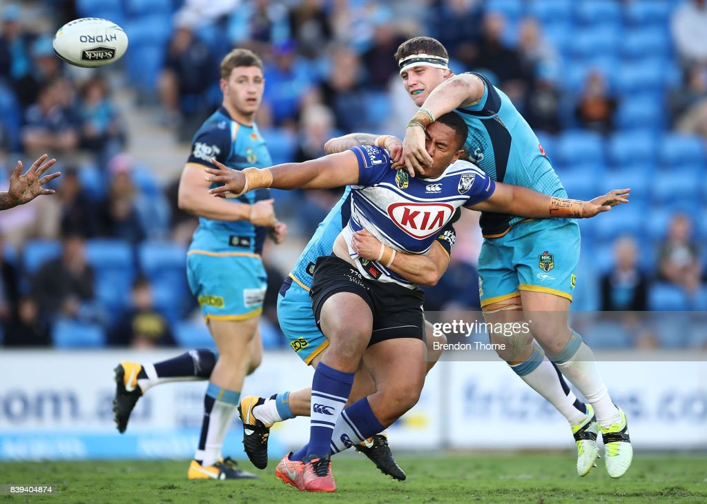 Francis Tualau of the Bulldogs offloads the ball during the round 25 NRL match between the Gold Coast Titans and the Canterbury Bulldogs at Cbus Super Stadium on August 26, 2017 in Gold Coast, Australia.