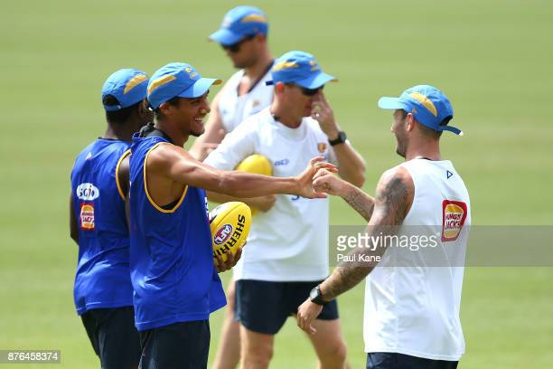 Francis Watson of the Eagles interacts with Chris Masten during a West Coast Eagles AFL training session at Lathlain Park on November 20 2017 in...