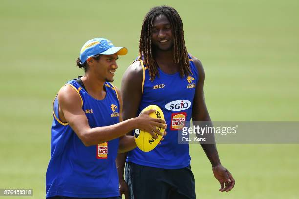 Francis Watson of the Eagles talks with Nic Naitanui during a West Coast Eagles AFL training session at Lathlain Park on November 20 2017 in Perth...