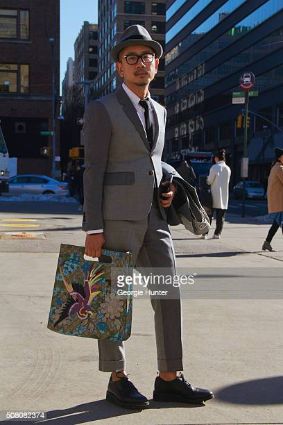 Francis Wong seen at Skylight Clarkson Sq outside the Duckie Brown show wearing full Thom Browne outfit with embroidered Gucci bag during New York...