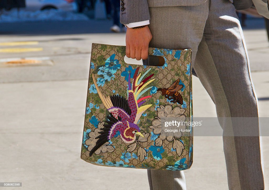 Francis Wong seen at Skylight Clarkson Sq outside the Duckie Brown show wearing Thom Browne suit and embroidered Gucci bag during New York Fashion...
