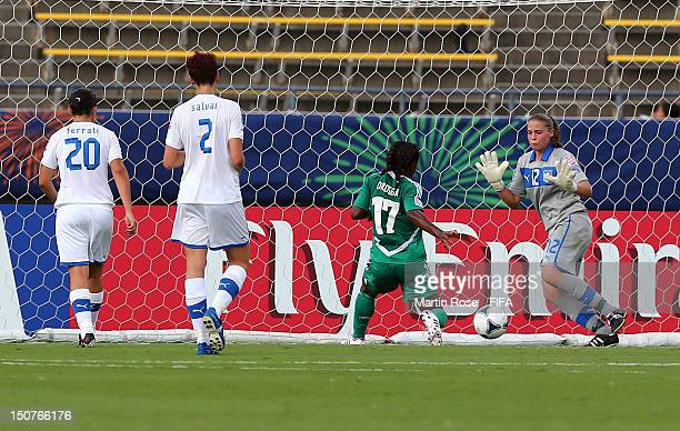 Francisca Ordega of Nigeria scores her team's opening goal during the FIFA U20 Women's World Cup 2012 group B match between Italy and Nigeria at Kobe...