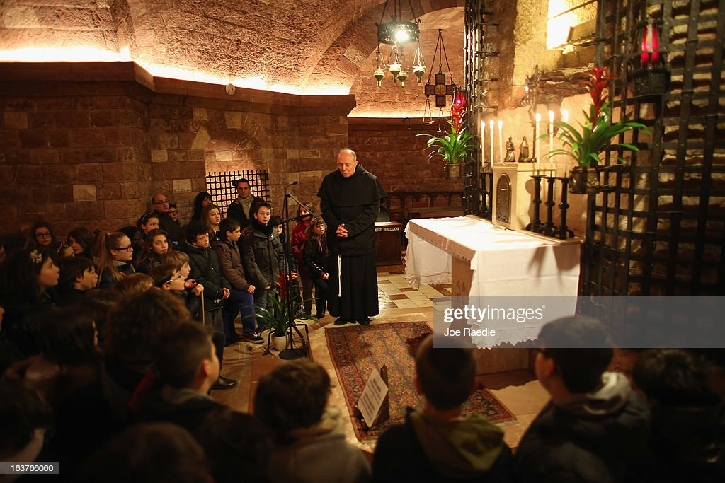 A Franciscan friar leads a prayer in front of the tomb of Saint Francis of Assisi as he prays at the Basilica of St. Francis of Assisi on March 15, 2013 in Assisi, Italy. Cardinal Jorge Mario Begoglio took the name Pope Francis after Saint Francis of Assisi who had renounced a life of privilege, by giving away all his possessions, wearing coarse woolen clothes and living in a humble hut after he took a vow of poverty.